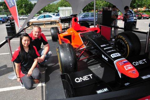 Adrian Beddow and Lesley Lee with the formula one car.