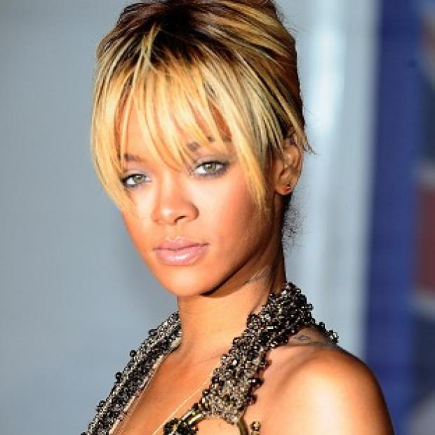 Rihanna's Talk That Talk has gone back to the top of the UK album charts