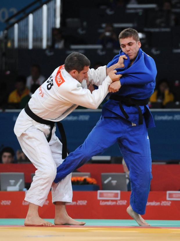 Picture by Anna Gowthorpe/PA Wire - Dan Powell in action against Cuba's Isao Cruz Alonso