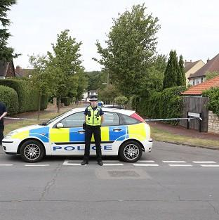 Police close to the home of Saad al-Hilli in Claygate, Surrey