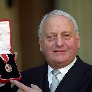 Sir Irvine Patnick receiving his knighthood at Buckingham Palace in 1994