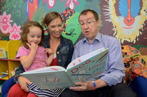 Story time: Mike Treacy with Denise Bolton and her daughter Nell, three