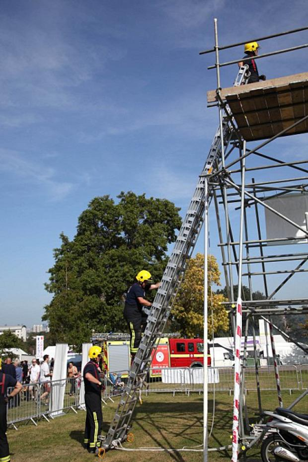 Firefighters climb at the Lambeth Country Show