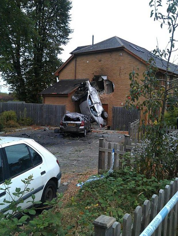 The silver Lexus flew into the side of this house in Bridge Road, Epsom, in September last year