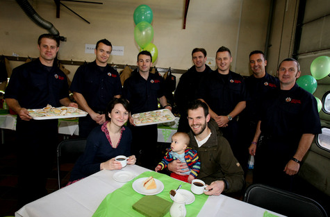 Firefighters Ben Johnson, Andy Stone, Andrew Black,Nick Lodge, Marc Lemon, Michael Tyrell-Price and Steve White with customers Nicky and Tristan Vetta with baby Seb.