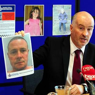 Detective Superintendent Reg Bevan holding up a photo of Mark Bridger who has been arrested during the probe into the abduction of April Jones