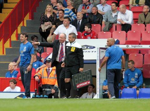 Dougie Freedman (left) looks on as his assistant Lennie Lawrence questions the fourth official in the 2-1 win over Sheffield Wednesday