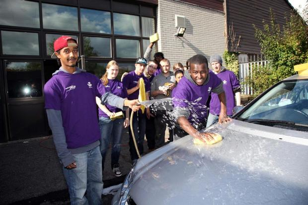 The group from Mitcham Prince's Trust: Samson and Yasser Araye washing a Mercedes