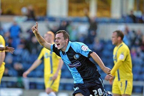Josh Scowen celebrates his goal against Torquay
