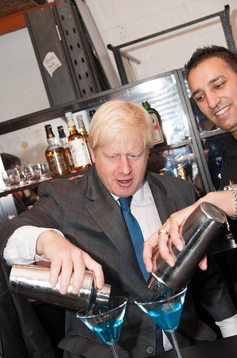 London Mayor Boris Johnson mixing a new cocktail dubbed the Bexley Breeze Block on a visit to Mobile Bar Hire in Crayford