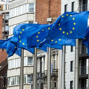 Flags wave at the European Commission headquarters in Brussels as it was announced the European Union won the Nobel Peace Prize (AP)