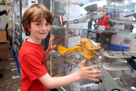 Oscar Jenkins (7) admiring model planes at the exhibition when it was in Kingston market place