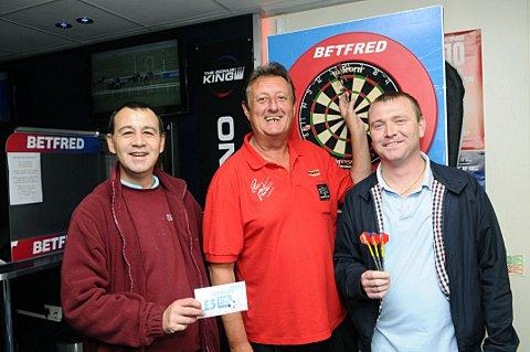 Eric Bristow plays darts at Greenwich Betfred before I'm A Celebrity... Get Me Out Of Here