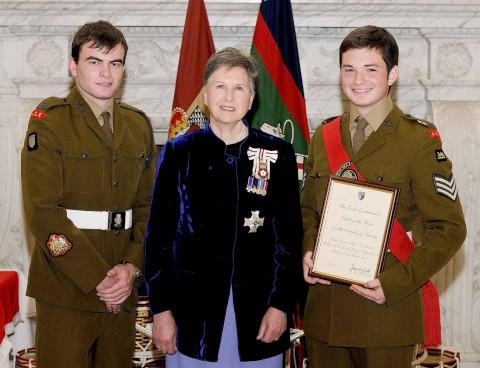 Awards: Sergeant Major James Bamforth, 18, and Cadet Drum Major Alexander Odeneal, 16, both from Walton, with Dame Sarah Goad