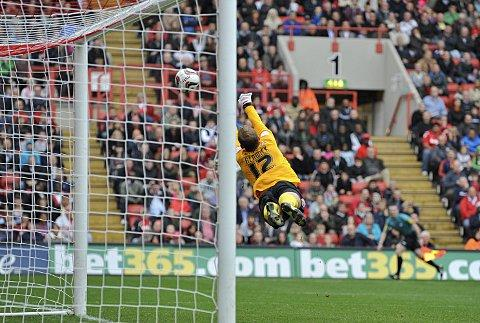 Barnsley keeper Ben Alnwick makes a fine stop from Abdul Razak's free-kick. PICTURES BY ALAN STANFORD.