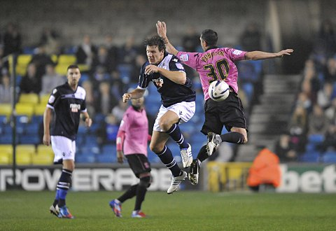 Darius Henderson wins a header against Paul Robinson