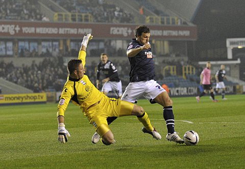 Darius Handerson bears down on Jack Butland