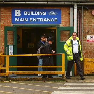 Workers leave the Ford Transit Assembly Plant in Southampton, after being told that the site will close site with the loss of up to 1,500 jobs