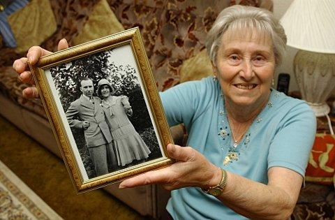 Mavis Bradley proudly holds a photo of her parents at her Slade Green home.