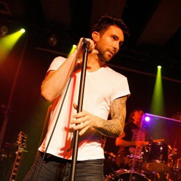 Adam Levine is standing up for Christina Aguilera