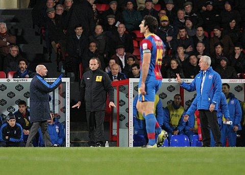 Return of the jiggle: Holloway and McCarthy have a debate at Selhurst Park, as the Palace manager rediscovers his