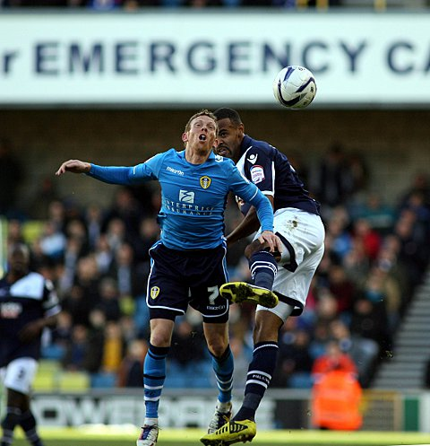 Liam Trotter and Paul Green challenge for a header