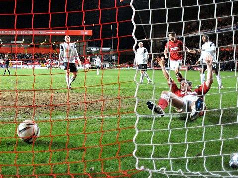 Yann Kermorgant scores Charlton's second last night. PICTURES BY KEITH GILLARD.