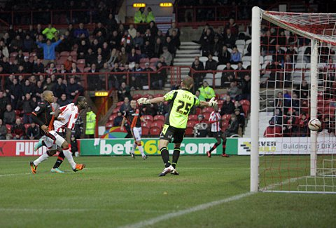Perfect 10: Clayton Donaldson guides home the opener at the weekend to notch his 10th goal of the campaign