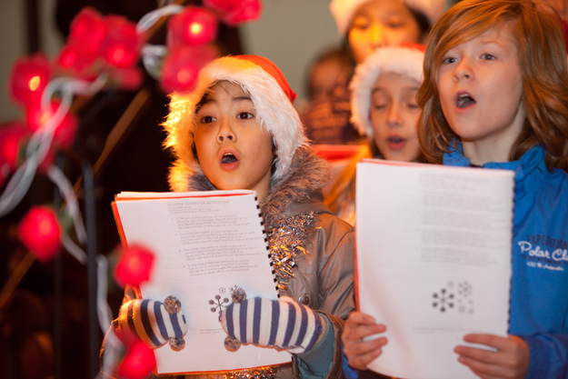 Children sing at last year's light switch on