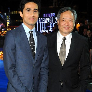 Suraj Sharma (left) and Ang Lee arriving for the premiere of Life of Pi at the Empire Leicester Square, London