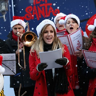 Caroline Flack leads a singalong for Text Santa