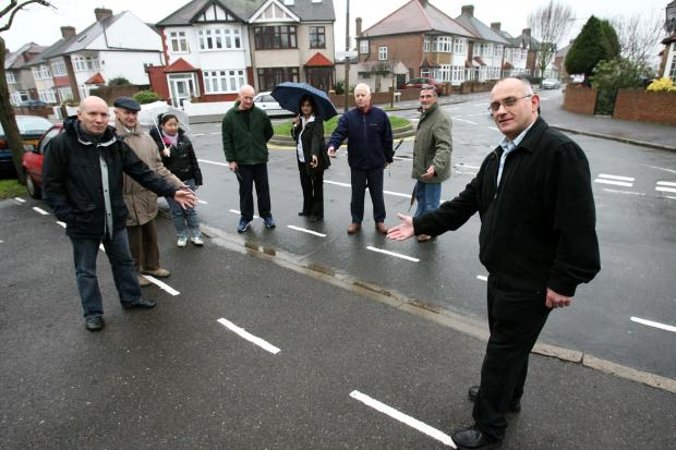 Angry residents with the parking bay lines painted in front of their driveways in Salters Road (EL5930-2/3)