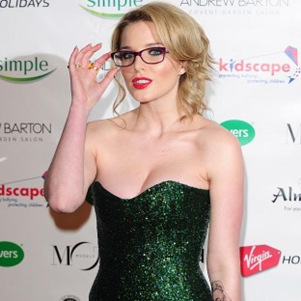 Helen Flanagan has apologised for tweeting a pic of herself posing with a gun