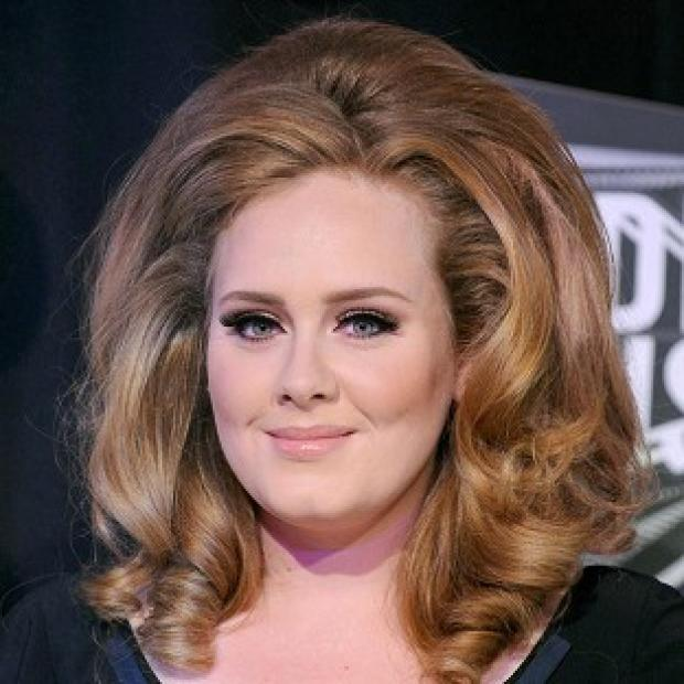 Adele's 21 is still topping the sales charts in the US