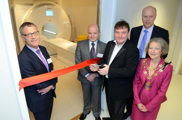Snooker legend Jimmy White and Chris Grayling opened the Clock House Alliance Imaging Centre in Dorking Road, Epsom