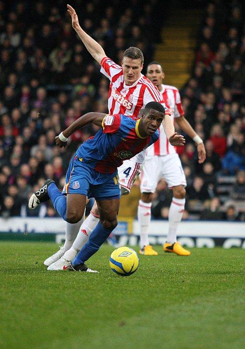 Problem man: Wilfried Zaha caused Stoke's defence, including Robert Huth, all manner of problems but he could not find a way past        SP72883