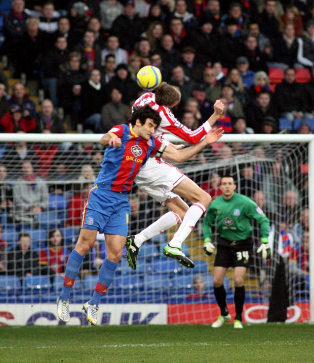 Mile Jedinak and Peter Crouch challenge for a header. PICTURE BY EDMUND BOYDEN.