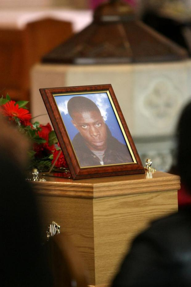 A photograph of Henry Bolombi pictured at his funeral in 2008