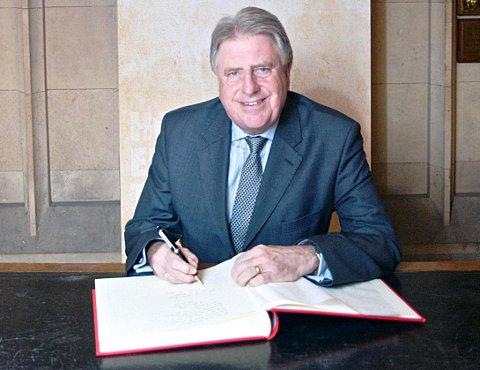 MP David Evennett signs a Book of Commitment at the House of Commons.
