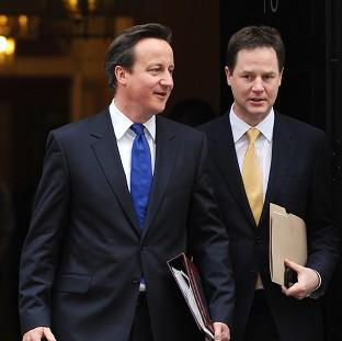 Nick Clegg, right, said David Cameron's promise to renegotiate Britain's place in Europe was 'vague'