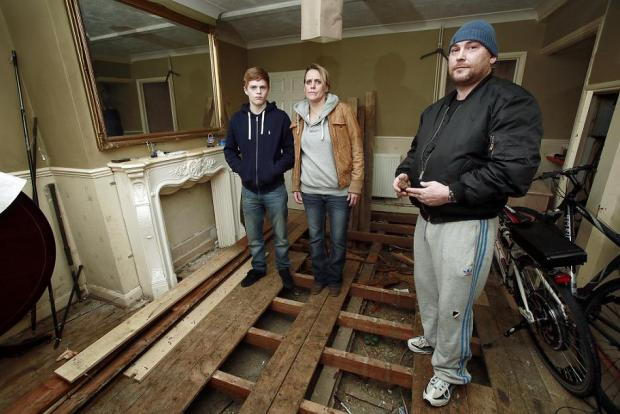 Amanda Eaton with James and Dean Perry in the ruins of their living room