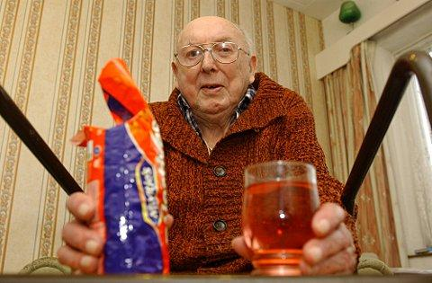 Len Baker with the biscuits and drinks he has to take to bed with him every night.