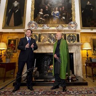David Cameron is to meet President Hamid Karzai of Afghanistan