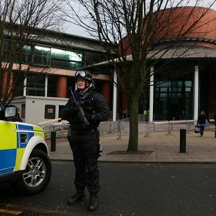 This Is Local London: An armed police officer stands outside Preston Crown court as the trial of Dale Cregan begins