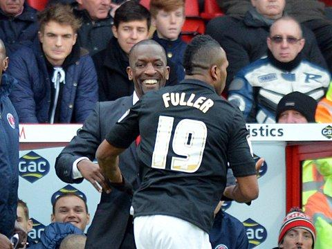 Ricardo Fuller celebrates his early goal with Chris Powell - but there was nothing to smile about for the Addicks at the final whistle. PICTURE BY KEITH GILLARD.