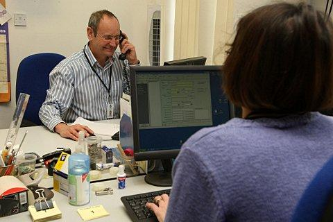 Manager Tom Sheriff working at Epsom & Ewell Citizens Advice Bureau