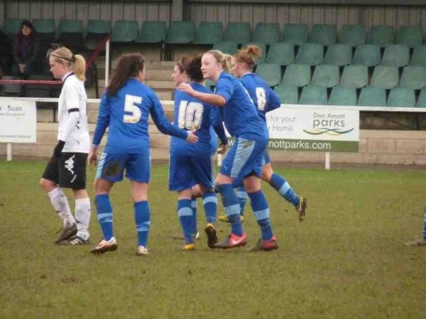 Celebrations for Jo Wilson's first goal