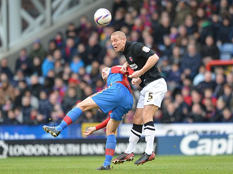 Michael Morrison wins a header