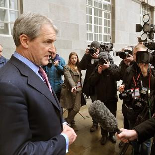 Environment Secretary Owen Paterson speaks to the media outside Defra headquarters in central London
