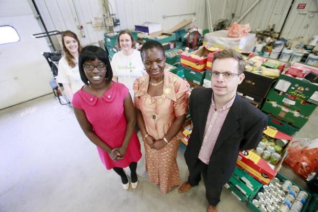 Louise Broni-Mensah, manager of North Enfield Foodbank, Mayor of Enfield Councillor Kate Anolue and David Pask director of North Enfield Foodbank